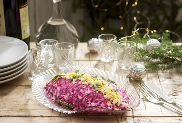 Traditional soviet festive salad of herring and vegetables