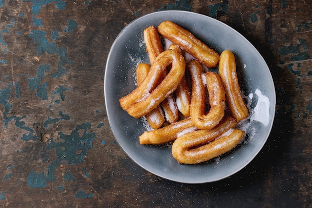 Traditional spanish churros with sugar