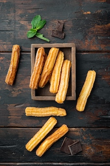 Traditional spanish dessert churros with sugar and chocolate