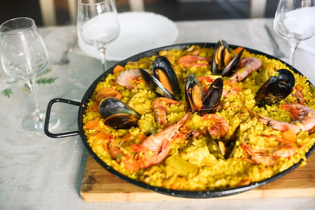 Traditional spanish dish paella with prawns and mussels