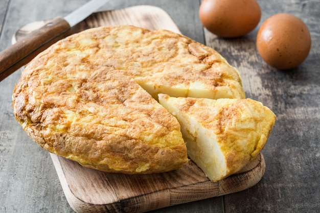 Traditional spanish omelette on rustic wooden table