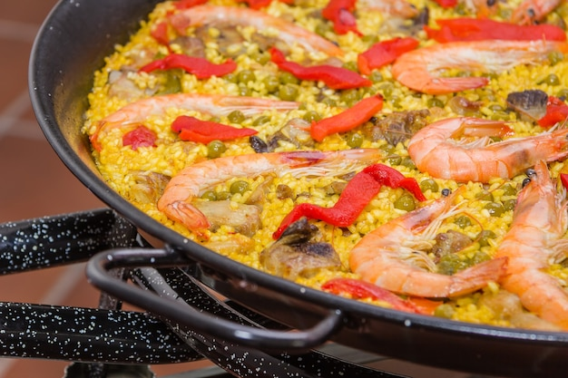 Traditional spanish paella cooked in a pan