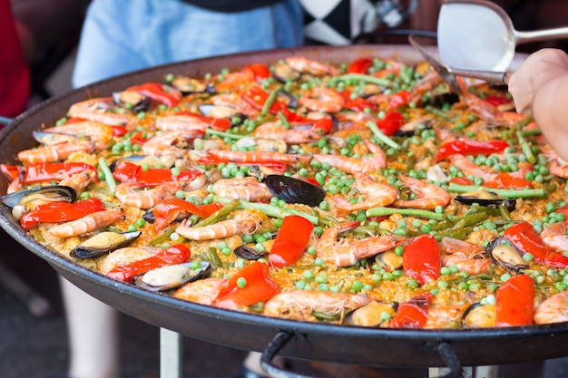 Traditional spanish rice paella with sea food. mixed seafood stir fried spicy and salad. spicy seafood.