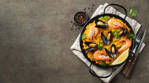 Traditional spanish seafood paella in pan.