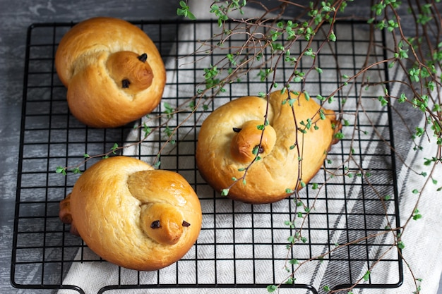 Traditional spring bird-shaped lean buns coated with sweet syrup.