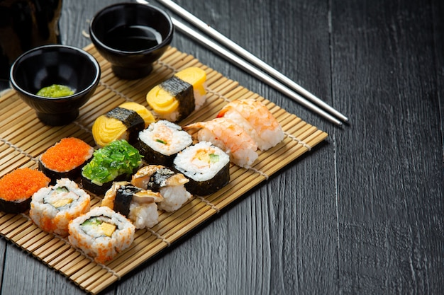 Traditional sushi on dark surface