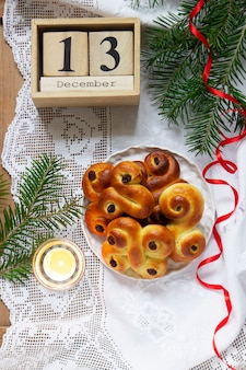 Traditional swedish saffron buns of various shapes on a light background. selective focus.