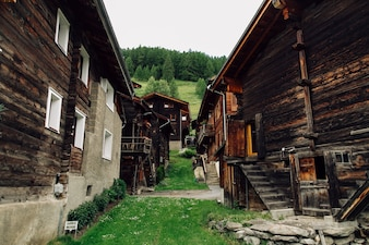 Traditional Swiss village with old wooden houses in Alps