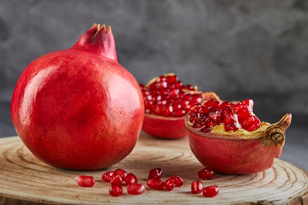 Traditional symbols: pomegranate whole and cut