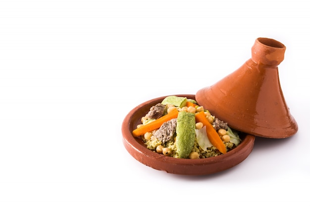 Traditional tajine with vegetables, chickpeas, meat and couscous isolated on white.
