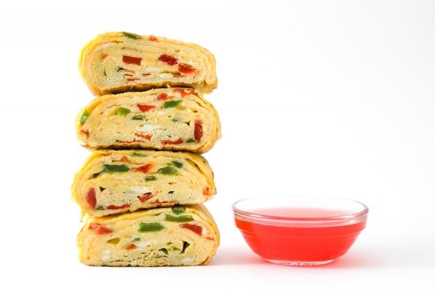 Traditional tamagoyaki japanese omelette isolated on white surface