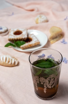Traditional tea with mint and assorted arab sweets