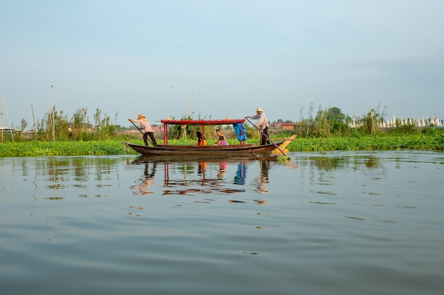 Traditional thai gondola boat with tourist in the river.