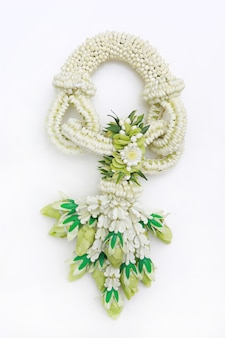 Traditional thai style fresh flower garland on white background. top view.