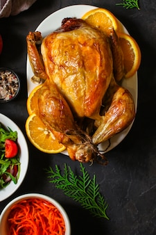 Traditional thanksgiving day chicken or turkey, christmas festive table setting food table, a lot of dishes menu . food . copyspace. top view