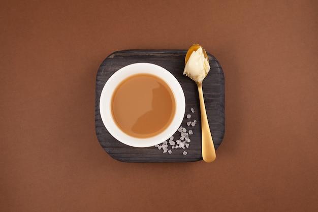 Traditional tibetan butter tea or churned tea in white bowl.