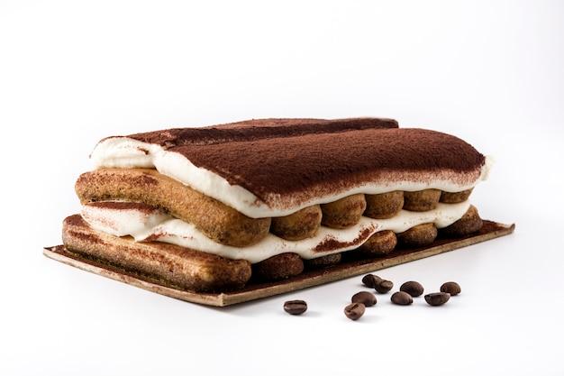 Traditional tiramisu cake isolated on white background