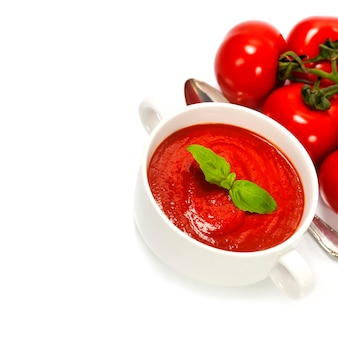 Traditional tomato soup and ingredients
