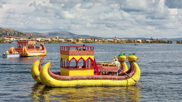 A traditional totora reed boats on the titicaca lake, puno. peru, south america
