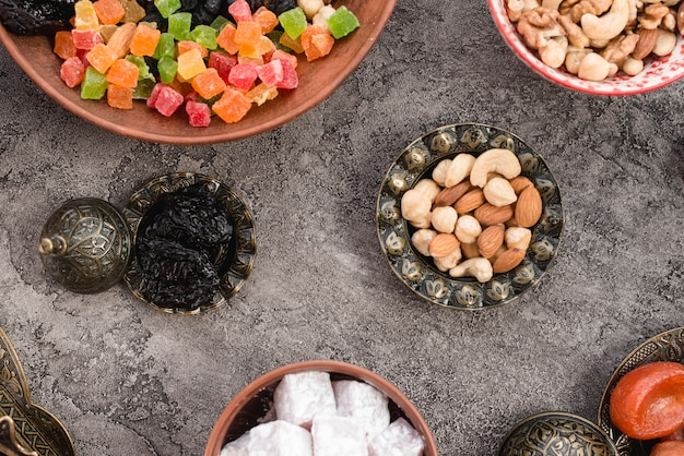 Traditional turkish arabic dried fruits and nuts on gray concrete backdrop