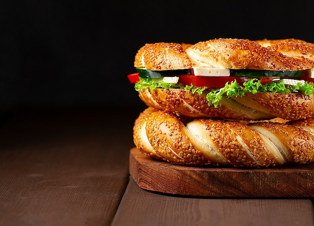 Traditional turkish bagel simit, breakfast, on a wooden table, rustic, horizontal, no people,. high quality photo