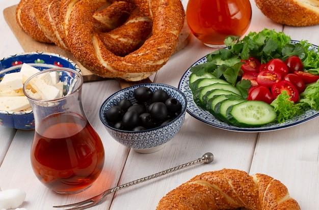 Traditional turkish bagel simit breakfast on a wooden table rustic
