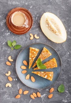 Traditional turkish candy cezerye from caramelised melon in blue plate