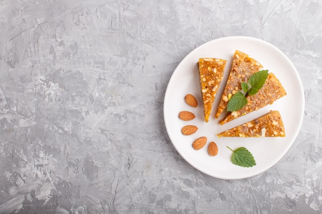 Traditional turkish candy cezerye from caramelised melon on white plate