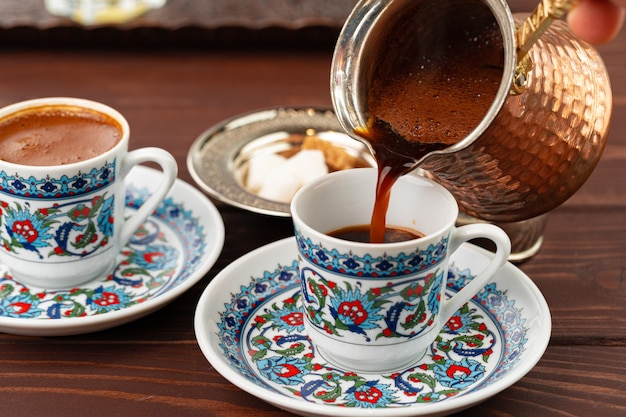 Traditional turkish coffee in oriental dishware close up photo