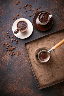 Traditional turkish coffee prepared on hot sand