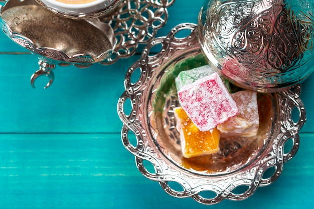 Traditional turkish coffee and turkish delight on wood.