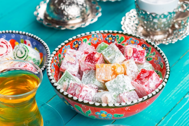 Traditional turkish coffee and turkish delight on wooden background.