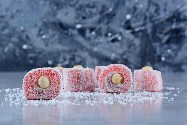 Traditional turkish delights with coconut powder on a stone surface