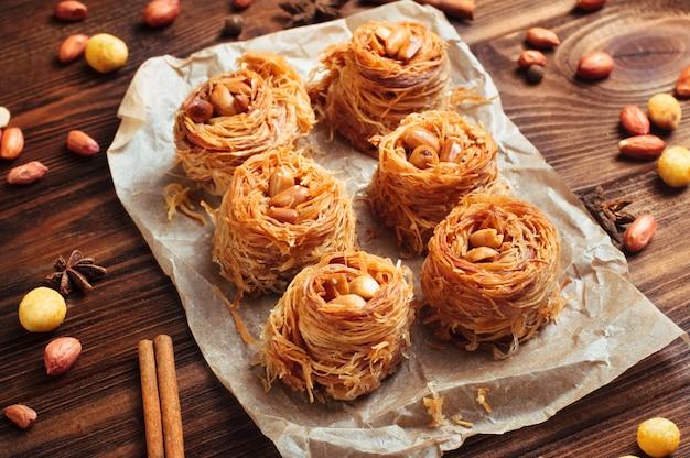 Traditional turkish dessert baklava nest with peanuts