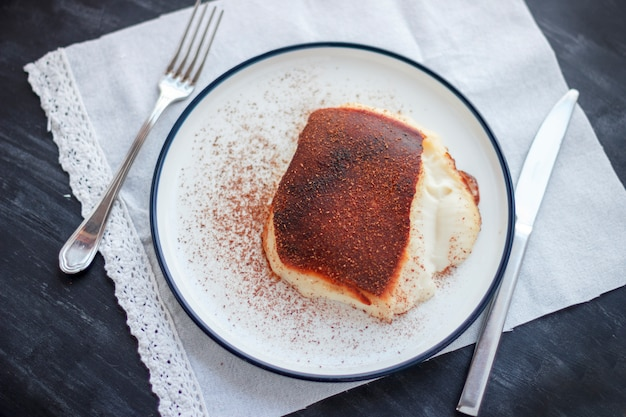 Traditional turkish dessert kazandibi with ground cinnamon