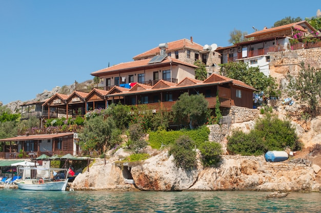 Traditional turkish houses on the mountain on the coastline