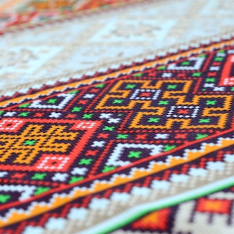 Traditional ukrainian folk art knitted embroidery pattern on textile fabric