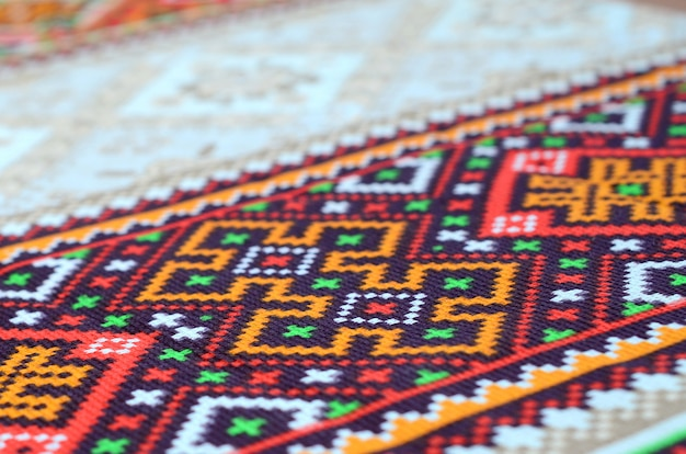Traditional ukrainian folk art knitted embroidery on textile fabric