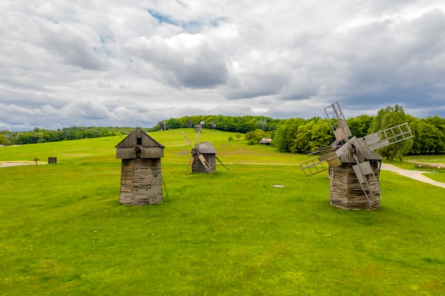 Traditional ukrainian wooden windmills in the park.