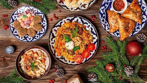 Traditional uzbek oriental cuisine. uzbek family table from different dishes for the new year holiday. the background image is a top view
