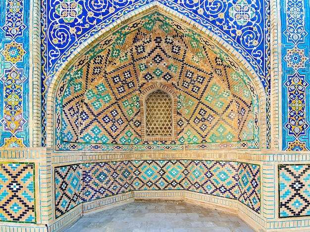 Traditional uzbek pattern on the ceramic tile on the wall of the mosque,