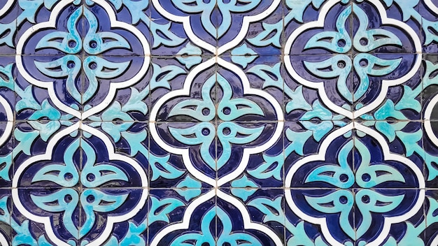 Traditional uzbek pattern on the ceramic tile on the wall of the mosque