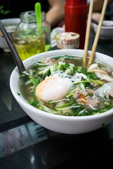 Traditional vietnamese pho bo noodle soup with egg