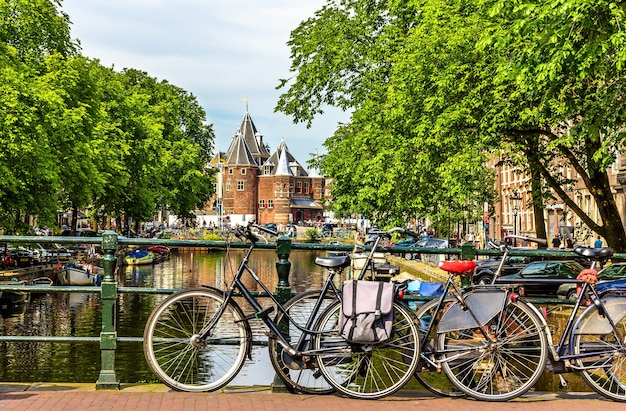 Traditional view of amsterdam with bicycles and canals