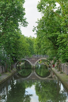 Traditional view on dutch canal in summer day. netherlands. utrecht city