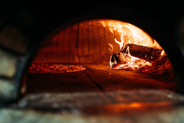 Traditional way baked pizza in a wood fired oven.