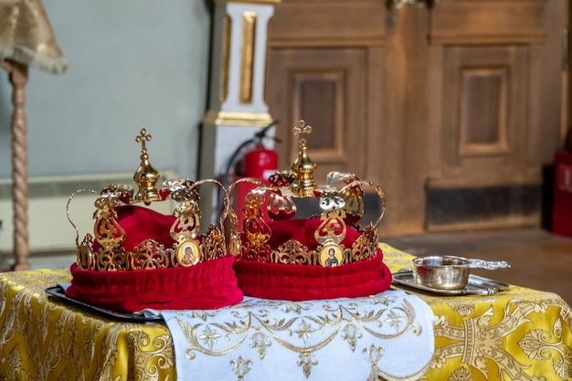 Traditional wedding crowns in a church. wedding crown in church ready for marriage ceremony