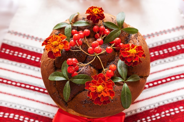 Traditional wedding ukrainian bread korovai with flowers,wedding round loaf with decoration. traditional wedding bread.wedding loaf of bread