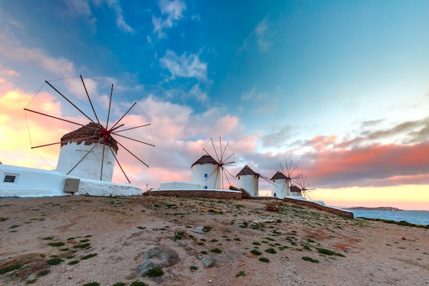 Traditional white windmills at sunrise, mykonos, greece