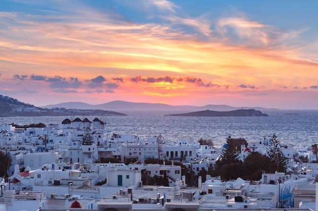 Traditional white windmills at sunset, mykonos, greece